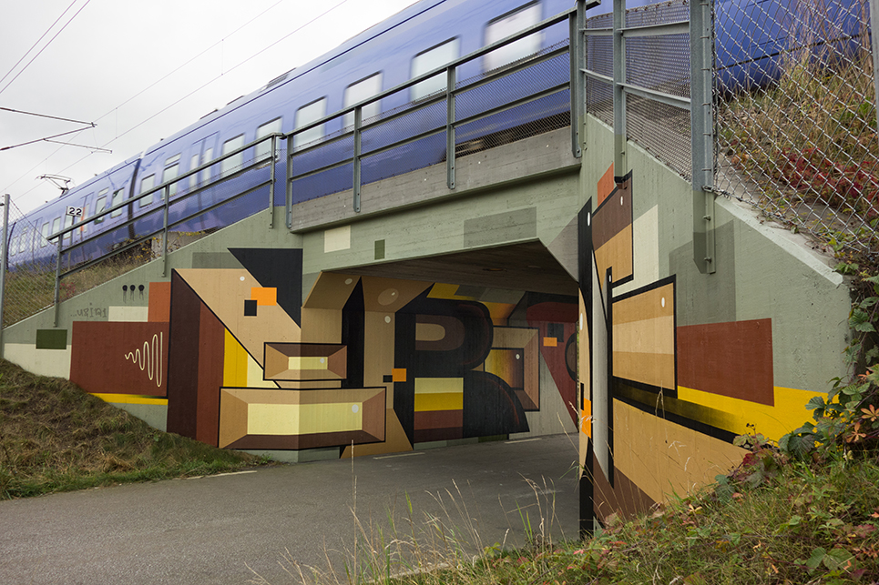 Graffiti art work  Gustav Norberg with purple train running on tracks above